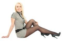 Mulher em pouco assento do vestido Imagem de Stock Royalty Free