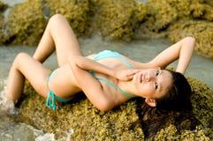 Mulher em rochas Foto de Stock Royalty Free