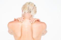 Mulher em topless bonita que toca em seu pescoço Fotografia de Stock Royalty Free