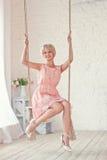 Mulher em um balanço Imagens de Stock Royalty Free