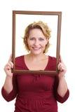 Mulher em um frame de madeira Foto de Stock Royalty Free