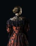 Mulher em um vestido do vintage foto de stock