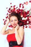 Mulher em um vestido vermelho imagem de stock