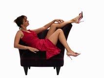 Mulher em uma cadeira fotografia de stock royalty free