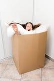 Mulher em uma caixa Imagem de Stock Royalty Free