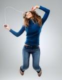 Mulher energética com jogador de música imagem de stock royalty free