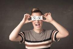 Mulher engraçada que olha com os olhos de papel tirados mão Fotos de Stock Royalty Free