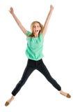 Mulher entusiasmado com os braços aumentados em Mid Air fotografia de stock