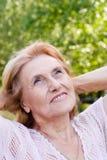 Mulher envelhecida agradável Fotografia de Stock