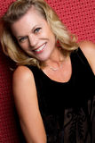 Mulher envelhecida média de sorriso Fotos de Stock