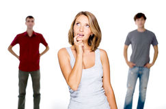 A mulher escolhe de dois homens novos Fotos de Stock
