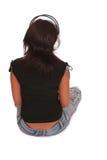 A mulher está escutando o musiÑ Foto de Stock