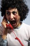 A mulher está indo louca no telefone vermelho Fotos de Stock Royalty Free