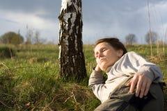A mulher está relaxando Foto de Stock Royalty Free