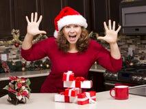 Mulher excitada durante o Natal Fotografia de Stock Royalty Free