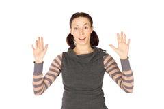A mulher Excited nas mãos levanta acima imagem de stock