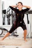 Mulher, exercício muscular da estimulação do ems eletro foto de stock