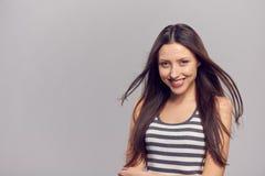 Mulher feliz com cabelo do vôo fotografia de stock