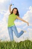 Mulher feliz com frasco Imagem de Stock