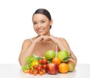 Mulher feliz com lote das frutas e legumes Fotos de Stock Royalty Free