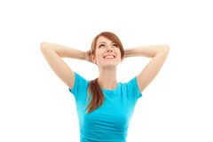 Mulher feliz com mãos atrás de sua cabeça Fotos de Stock Royalty Free