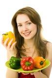 Mulher feliz com pimentas imagens de stock