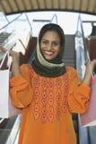 Mulher feliz com sacos de compras Imagens de Stock Royalty Free