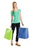 Mulher feliz com sacos de compras fotografia de stock