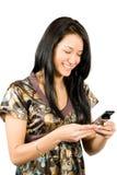 Mulher feliz com telefone móvel Imagem de Stock Royalty Free