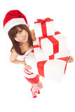 Mulher feliz de Santa com caixas de presente fotos de stock