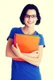 Mulher feliz do estudante com cadernos Foto de Stock