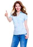 A mulher feliz heerful do ¡ de Ð com polegares levanta o sinal Foto de Stock