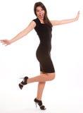 Mulher feliz no preto Imagens de Stock Royalty Free