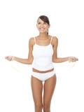 Mulher feliz no roupa interior que joga com corda de salto imagens de stock