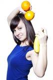 Mulher feliz nova com frutas Fotografia de Stock