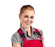 Mulher feliz nova em macacões vermelhos Imagem de Stock