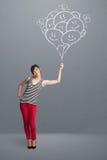 Mulher feliz que guardara desenhar de sorriso dos balões Fotos de Stock Royalty Free