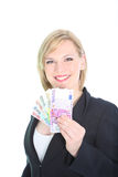 Mulher feliz que indica um ventilador de euro- notas Fotografia de Stock