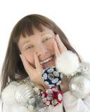 Mulher feliz que joga com decorações do Natal Imagens de Stock