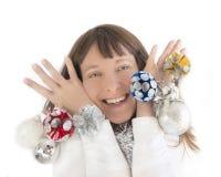 Mulher feliz que joga com decorações do Natal Imagens de Stock Royalty Free