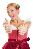 Mulher feliz que mantém ambos os polegares Imagens de Stock