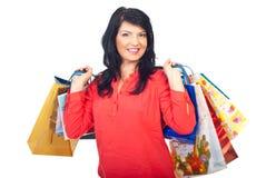 Mulher feliz que prende muitos sacos de compra Imagem de Stock Royalty Free