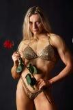 Mulher forte com uma rosa Imagem de Stock Royalty Free