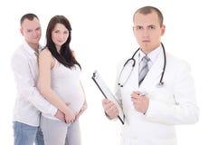 Mulher gravida bonita nova com seus marido e ginecologista Fotografia de Stock Royalty Free