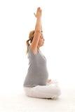 Mulher gravida bonita que faz exercícios fotos de stock royalty free