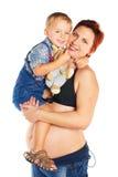 Mulher gravida com criança Fotografia de Stock