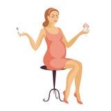 A mulher gravida come a sobremesa Fotografia de Stock Royalty Free