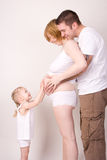 Mulher gravida da família Imagem de Stock Royalty Free