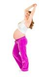 Mulher gravida de sorriso que faz exercícios da aptidão Fotografia de Stock Royalty Free