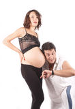 Mulher gravida e homem novos bonitos Imagem de Stock Royalty Free